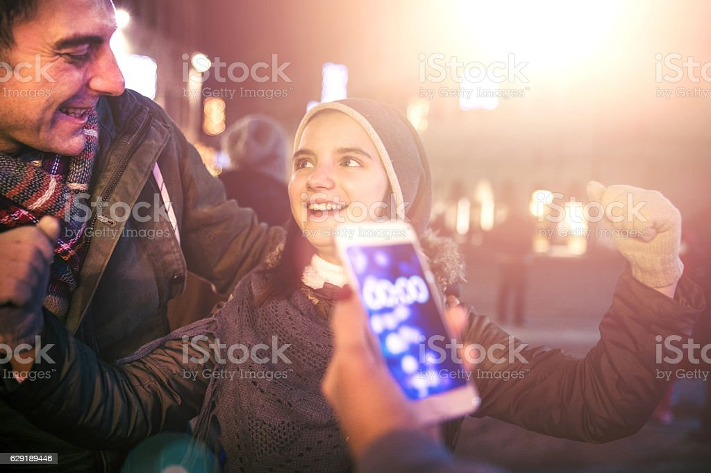 Father and daughter celebrate New Year's Eve together stock photo
