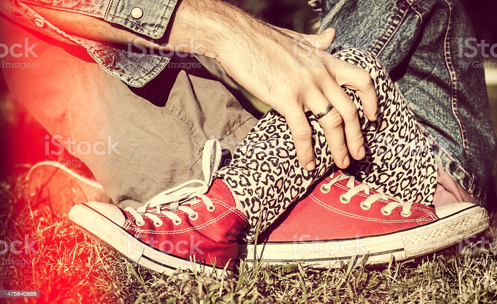 Father and daughter criss-crossed their sneakers stock photo