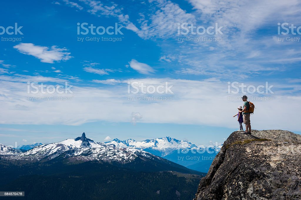 Father and daughter enjoying the great outdoors stock photo