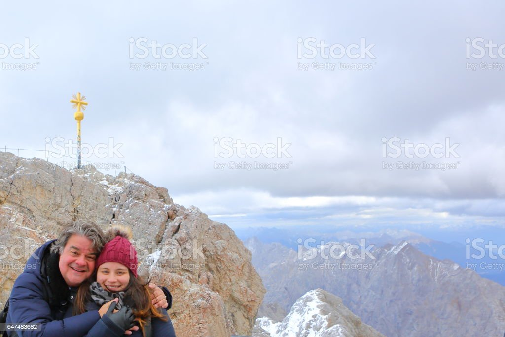 Father and Daughter Freezing at Zugspitze stock photo