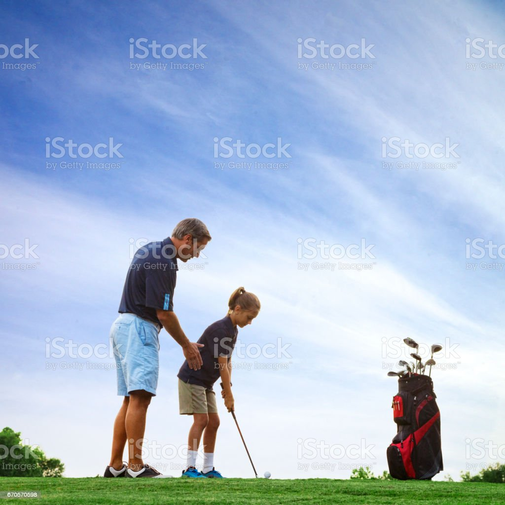 Father and Daughter Golf stock photo