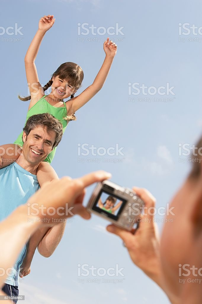 Father and daughter having picture taken stock photo