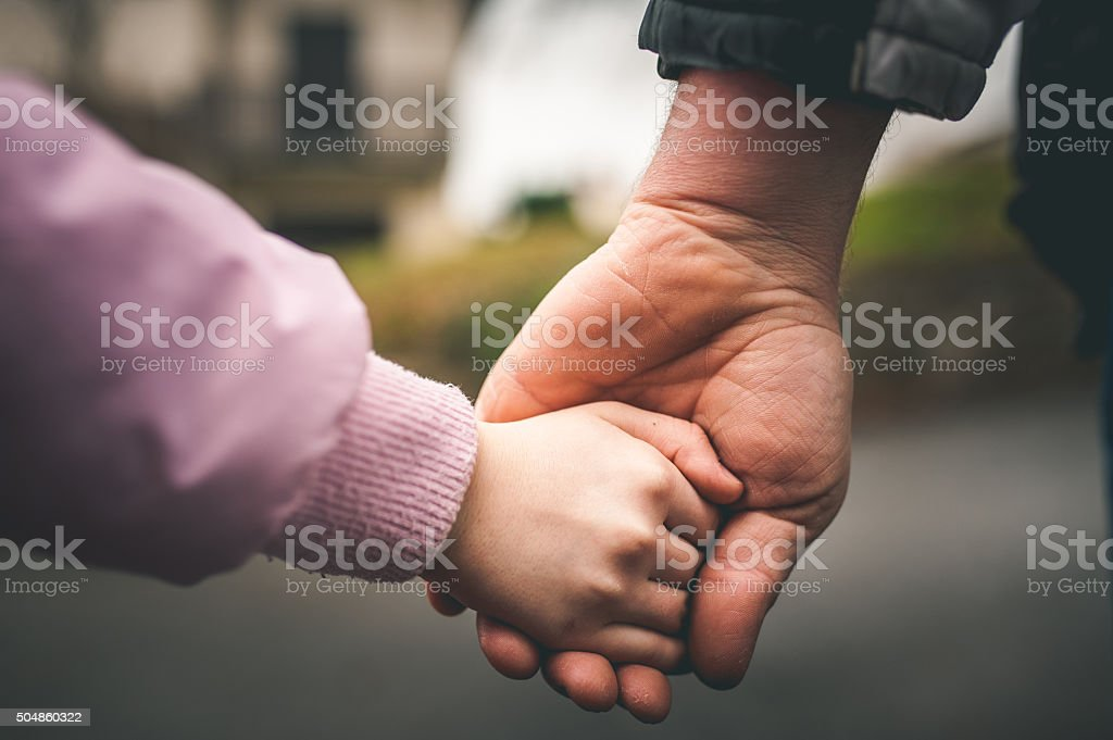 Father and Daughter Holding Hands stock photo