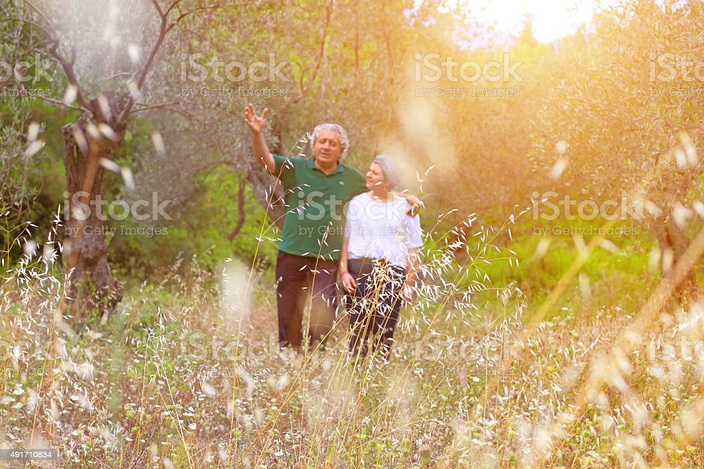 Father and Daughter Hugging In Nature stock photo