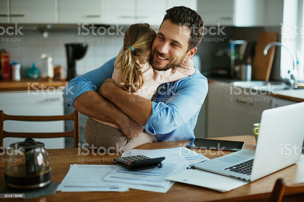 Father and daughter hugging stock photo