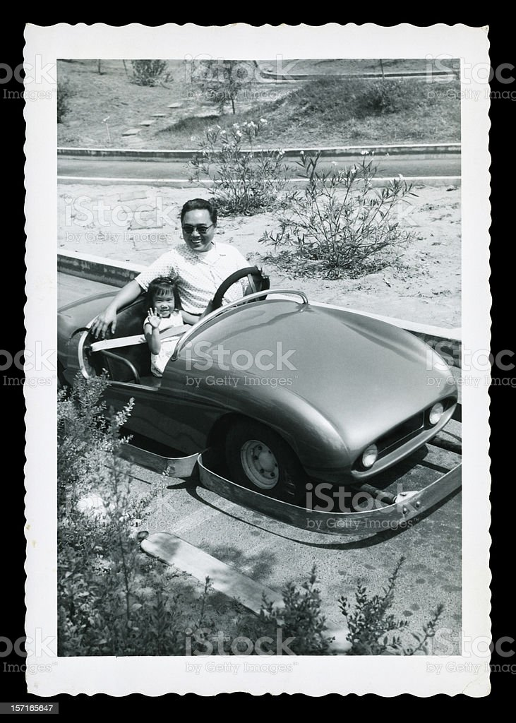 Father and Daughter in an Old Car royalty-free stock photo