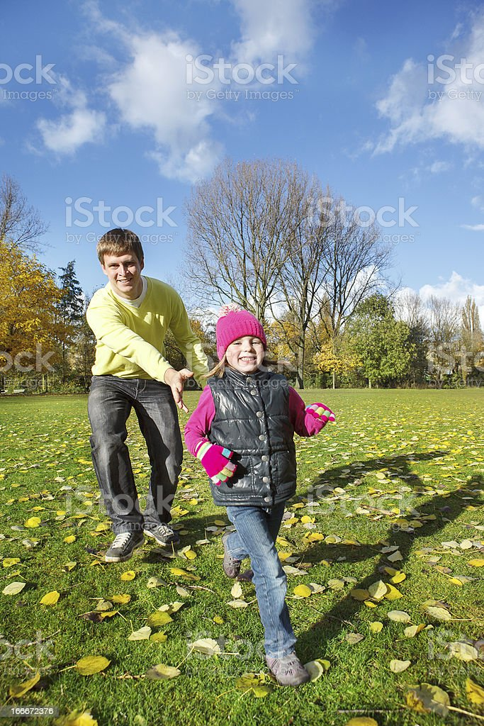 Father and daughter in autumn park royalty-free stock photo