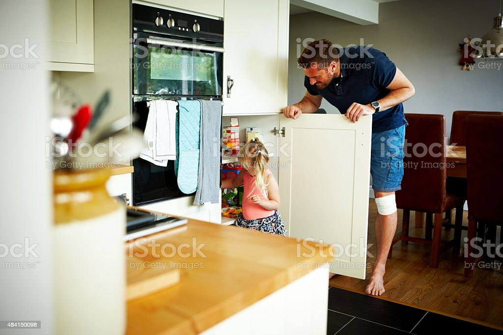 Father and daughter in kitchen stock photo