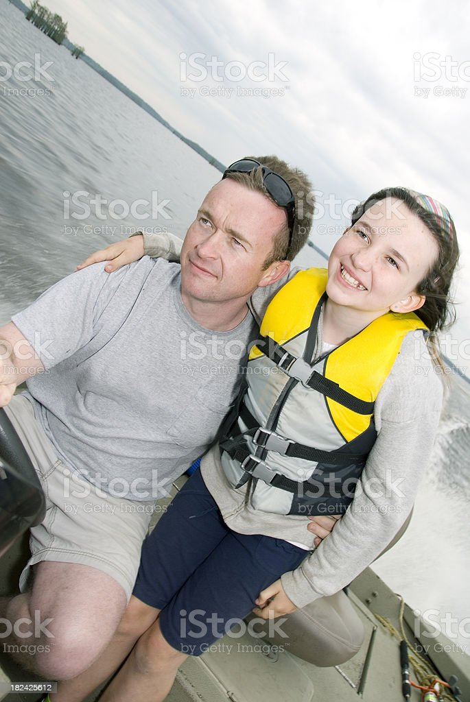 Father and Daughter in Life Jacket on Boat royalty-free stock photo