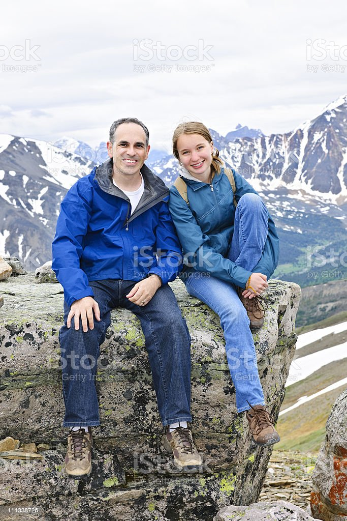 Father and daughter in mountains royalty-free stock photo