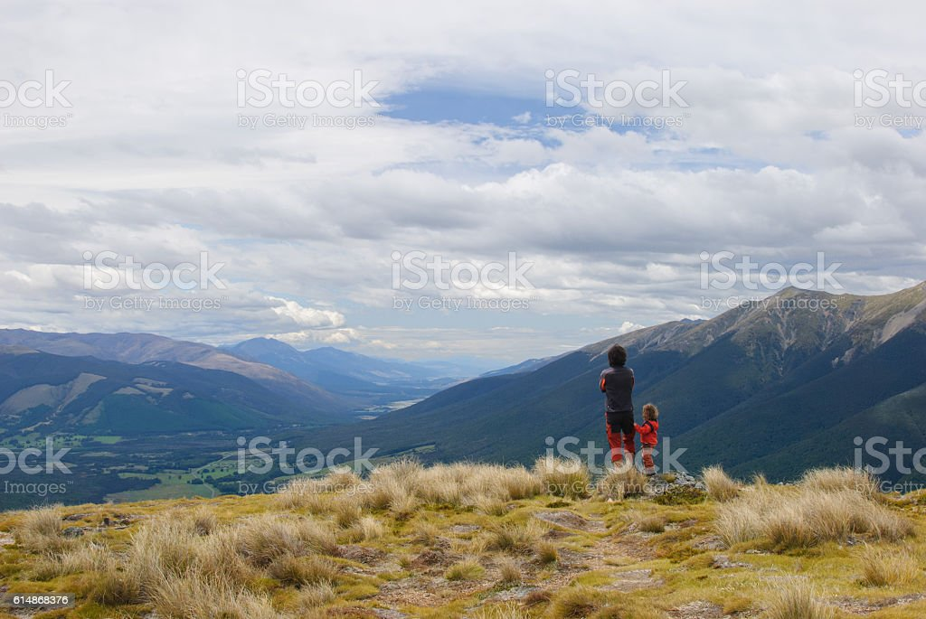 Father and daughter in the mountains stock photo