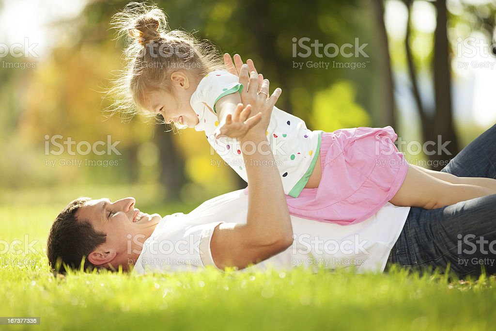 father and daughter in the park royalty-free stock photo