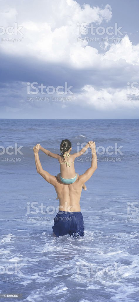 Father and daughter in the sea royalty-free stock photo