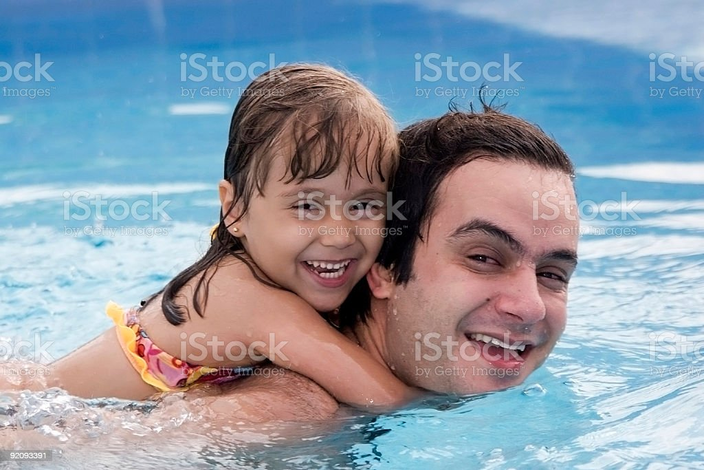 Father and daughter in the swimming pool royalty-free stock photo