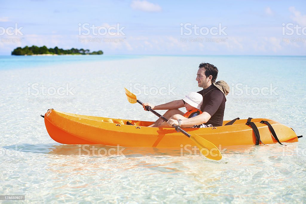 Father and daughter kayaking royalty-free stock photo
