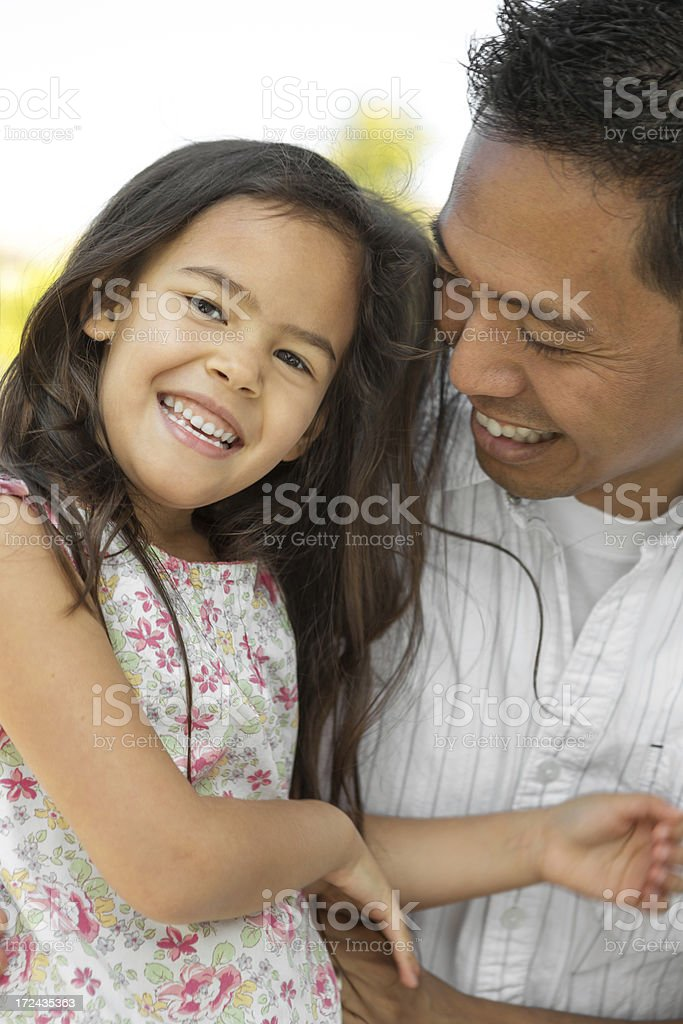 Father and daughter laughing stock photo