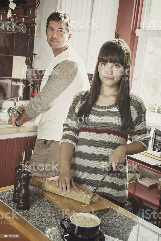 Father and Daughter Making Lunch stock photo