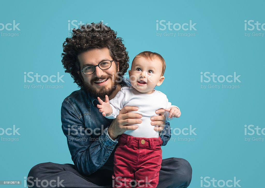 Father and daughter on blue background, Smiling portrait stock photo