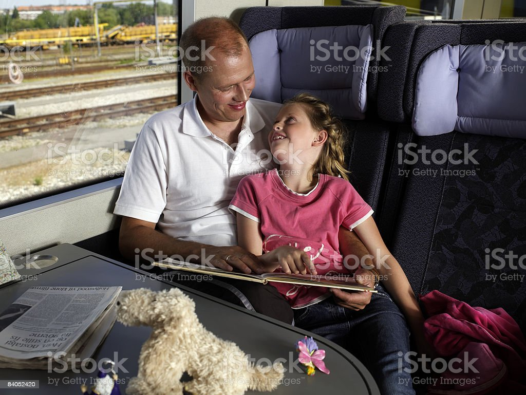 Father and daughter on train stock photo