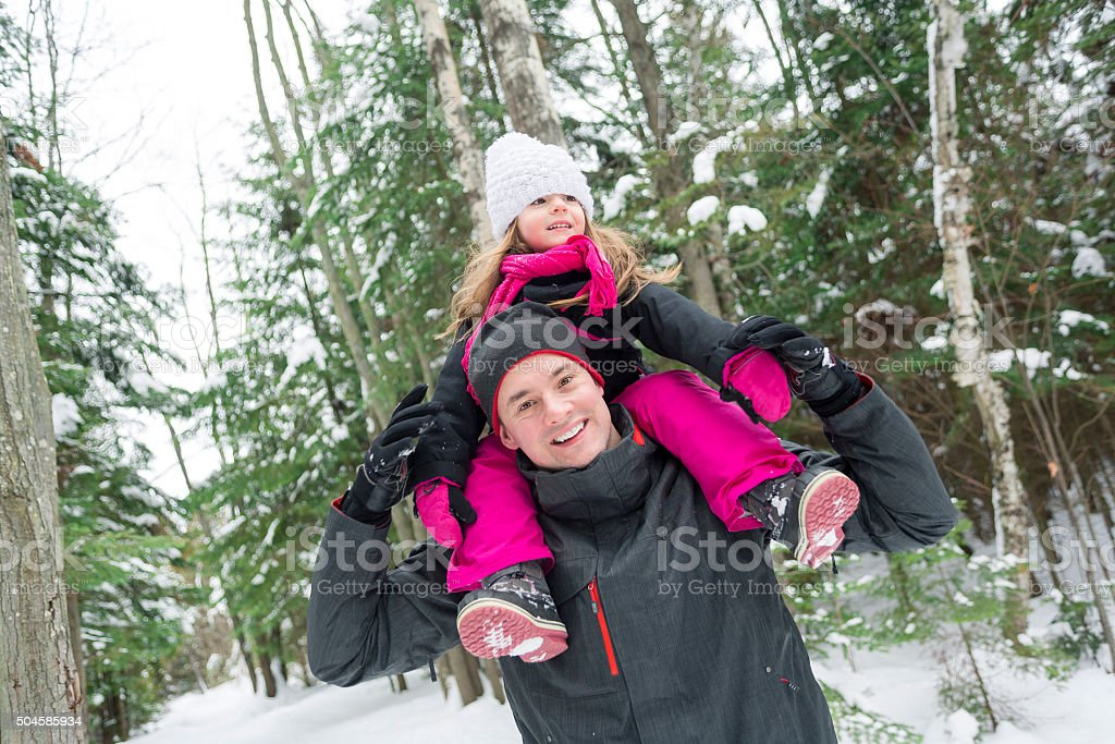 Father and daughter outdoor in the winter forest stock photo