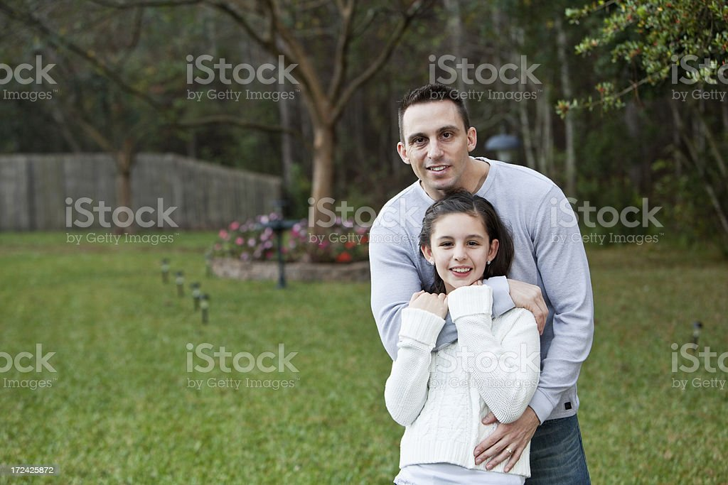 Father and daughter outdoors stock photo