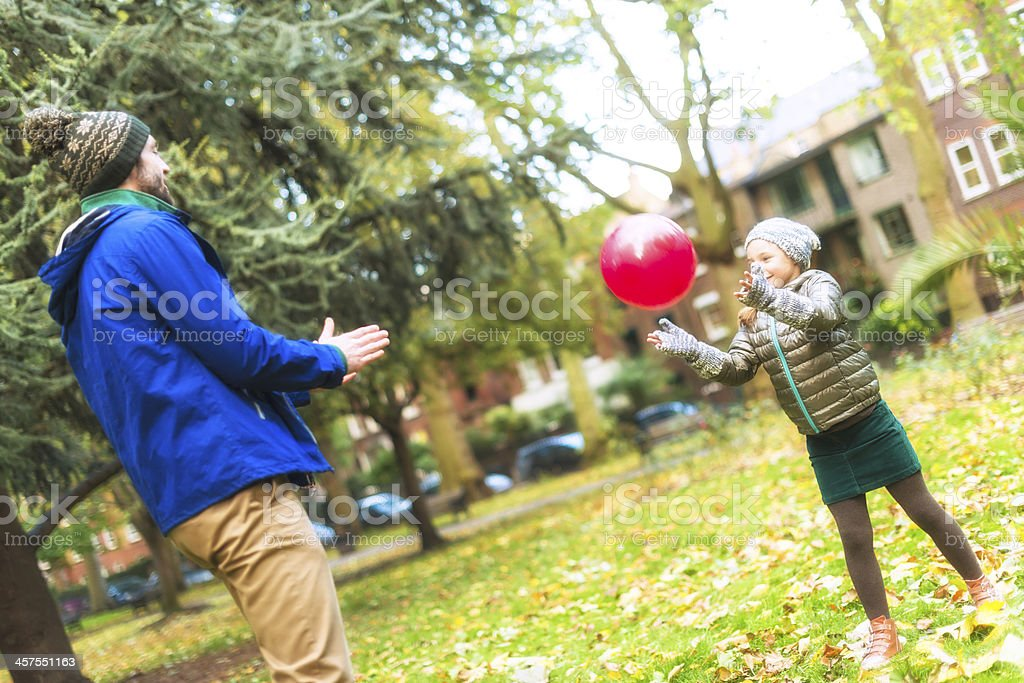 Father and daughter playing ball royalty-free stock photo