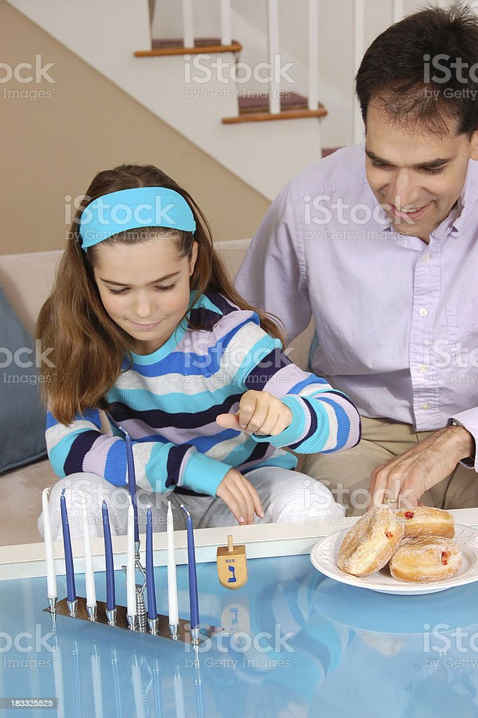 Father and Daughter Playing Dreidel stock photo