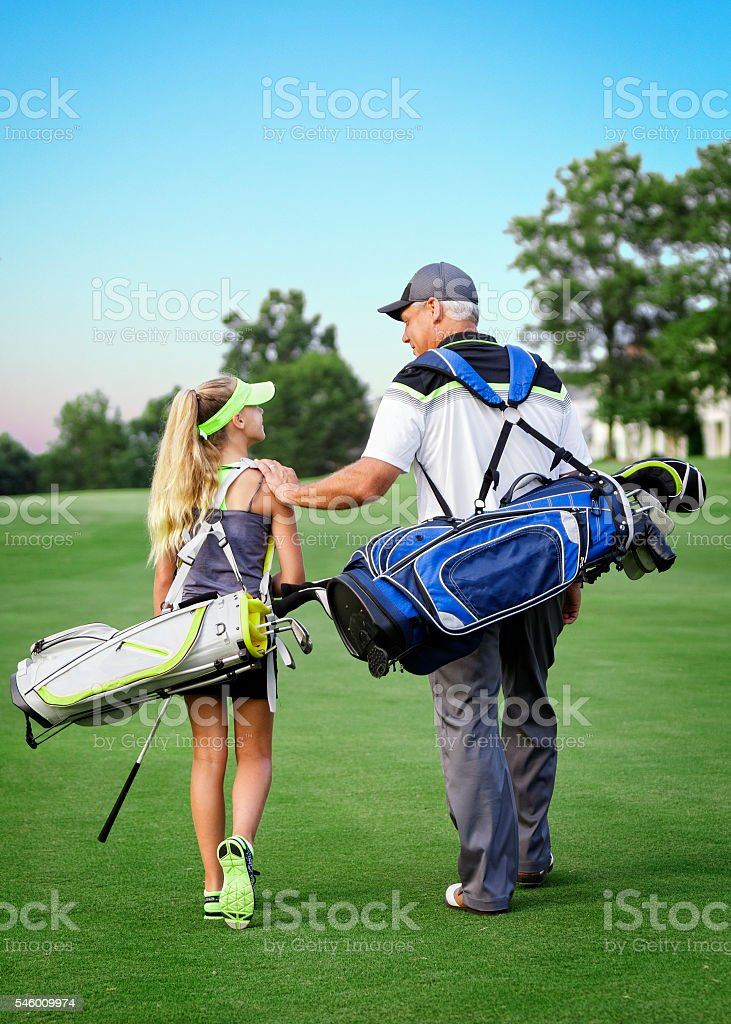 Father and Daughter Playing Golf stock photo