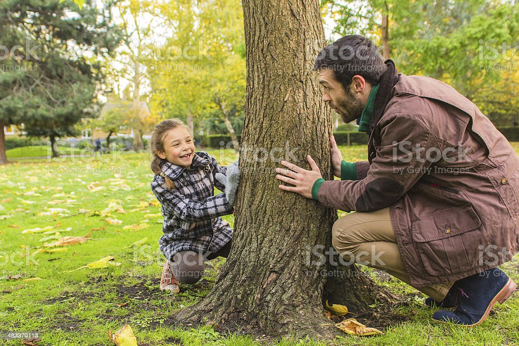 Father and daughter playing in the park stock photo