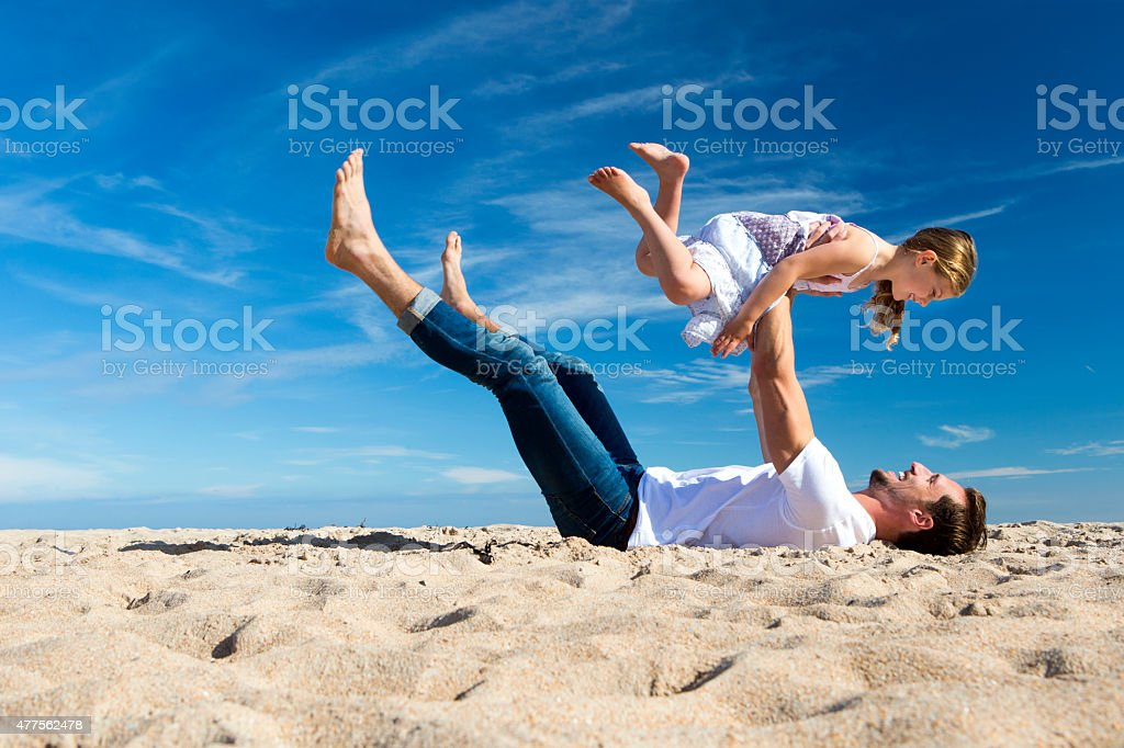 Father and Daughter Playing on the Beach stock photo