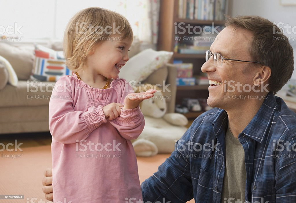 Father and daughter playing stock photo
