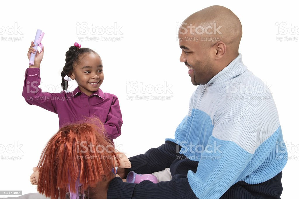 Father and Daughter Playing with Dolls royalty-free stock photo