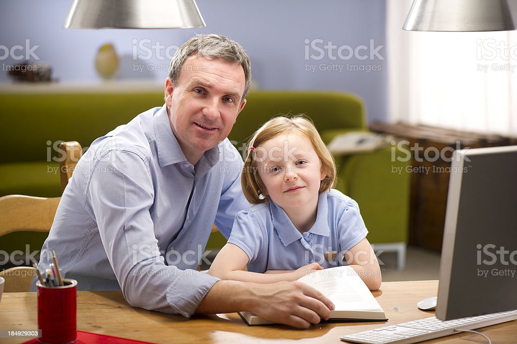 father and daughter reading royalty-free stock photo