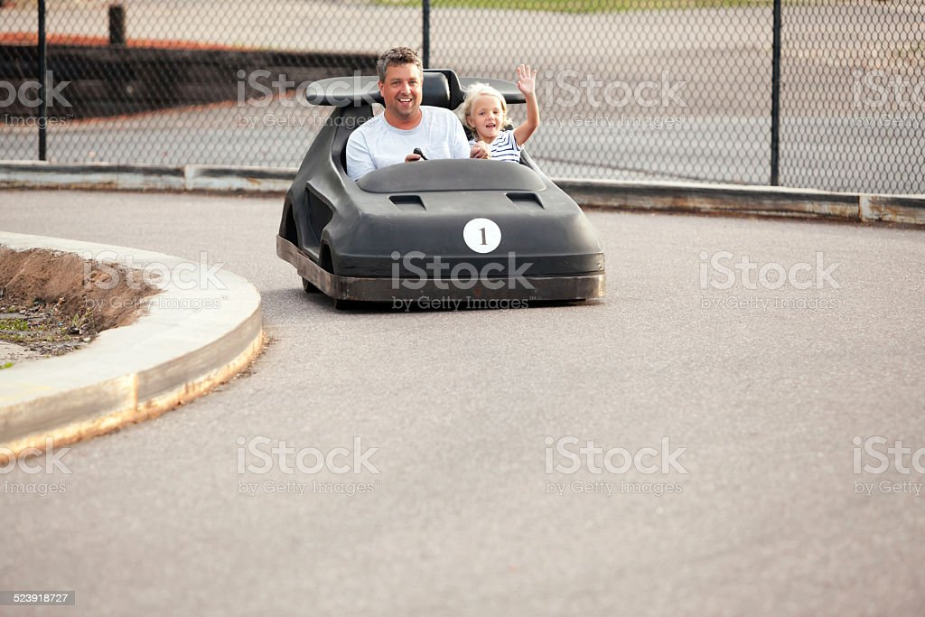 Father and Daughter Riding in Go Kart stock photo