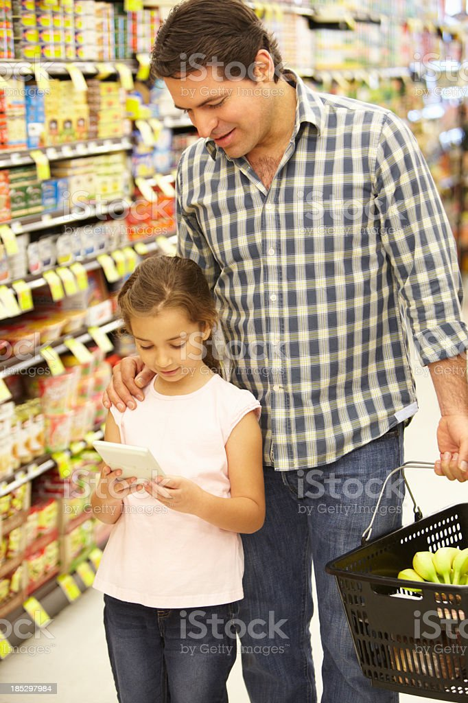 Father and daughter shopping royalty-free stock photo