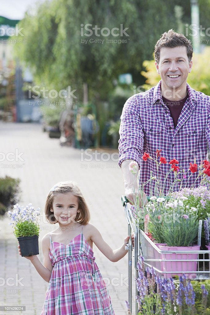 Father and daughter shopping together in nursery royalty-free stock photo