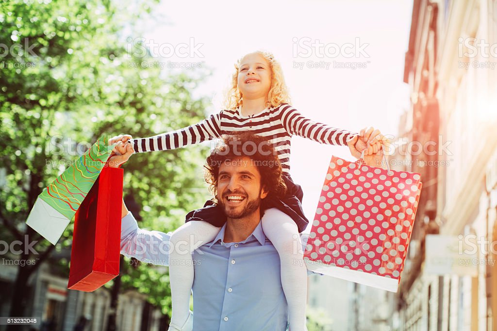 Father And Daughter Shopping Together. stock photo