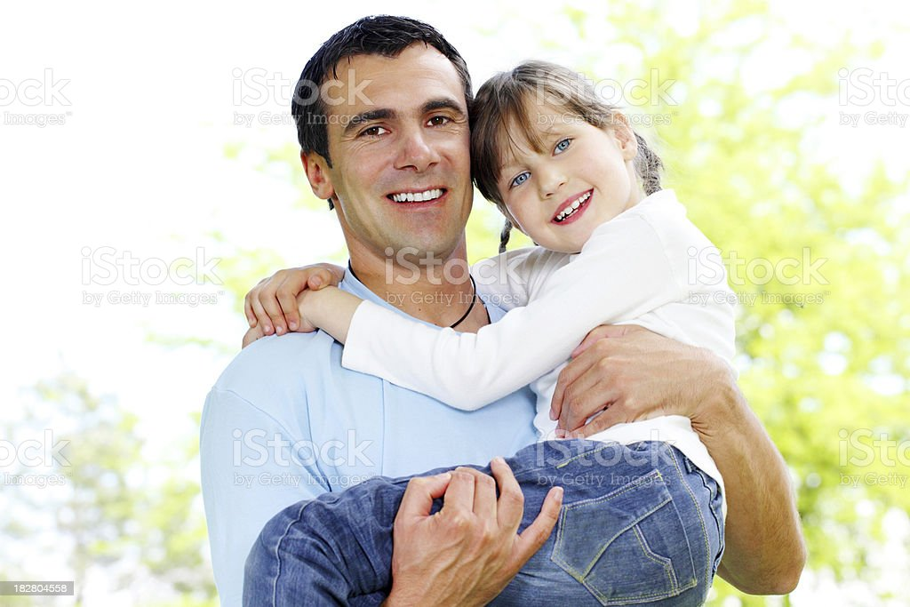 Father and daughter spend a day in the park. royalty-free stock photo