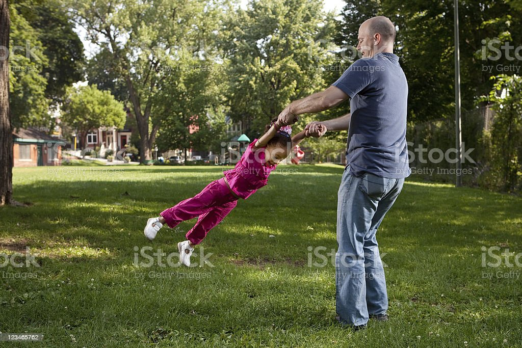 Father and Daughter Spinning stock photo
