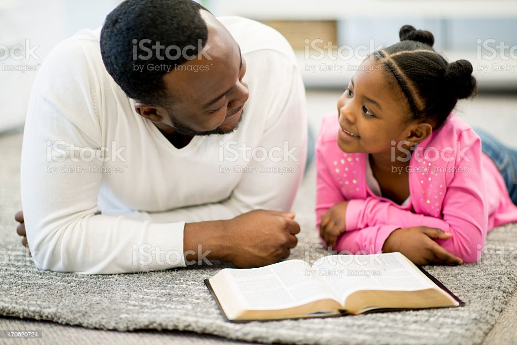 Father and Daughter Studying Bible stock photo