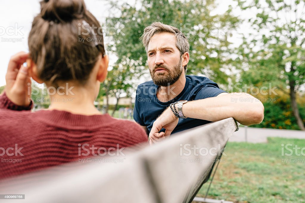 Father and Daughter talking stock photo