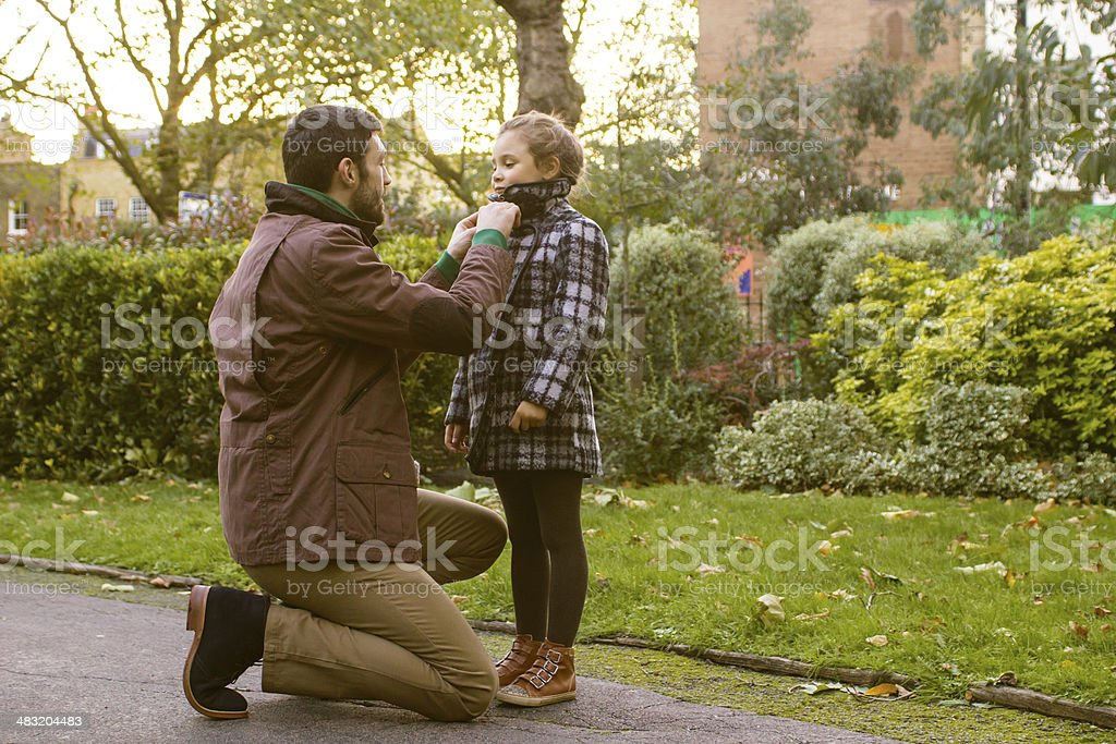 Father and Daughter Together at the Park in Autumn stock photo
