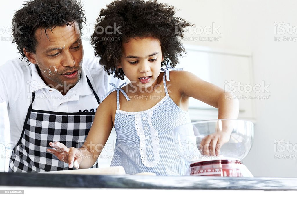 Father and daughter together baking stock photo