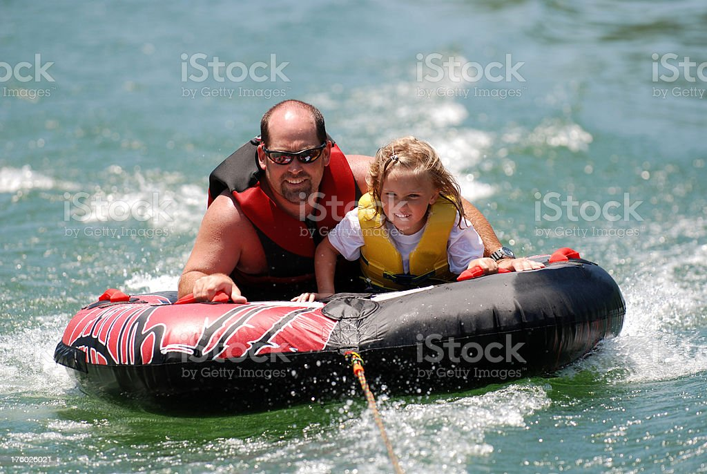 Father and Daughter Tubing royalty-free stock photo