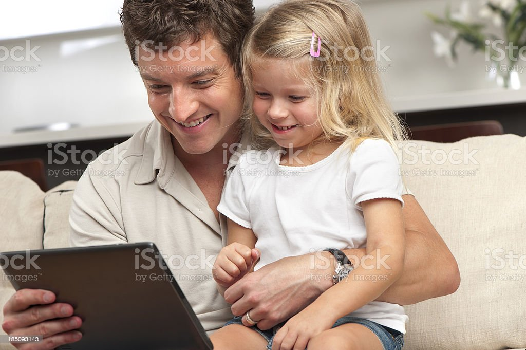 Father and daughter using a digital tablet royalty-free stock photo
