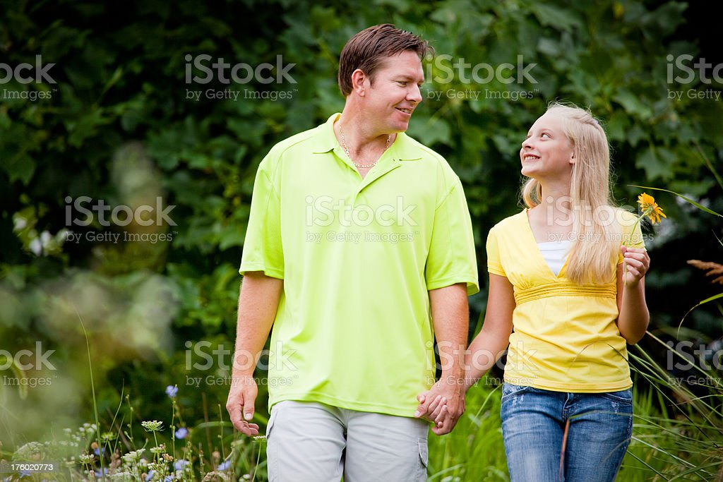 Father and Daughter Walking royalty-free stock photo