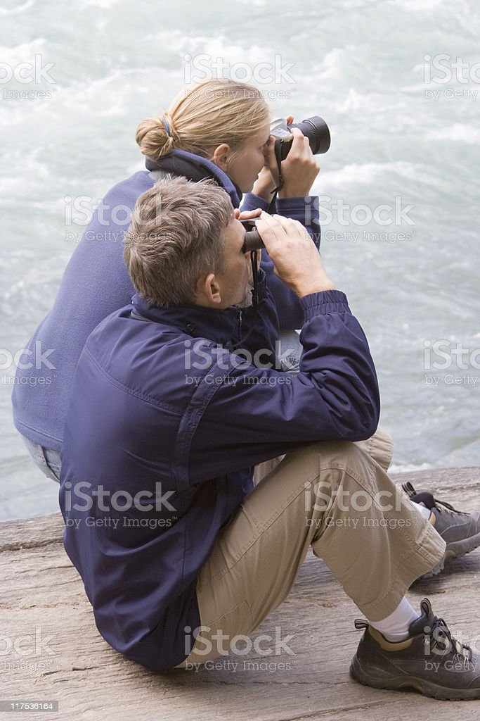 Father and daughter watching salmon run in Fraser River royalty-free stock photo