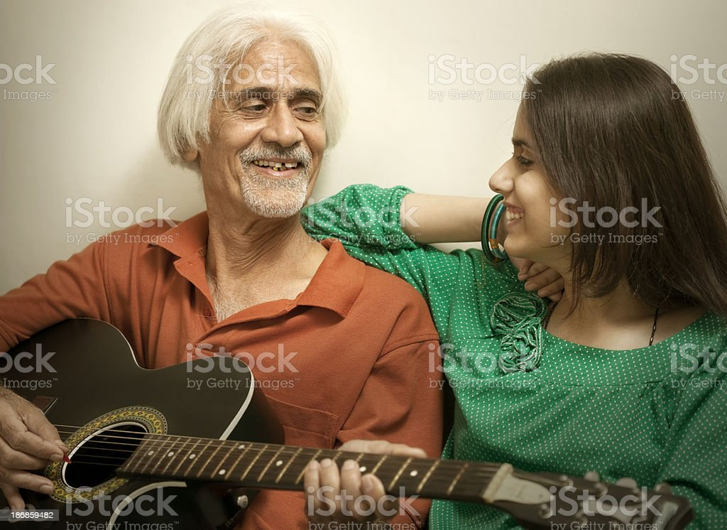 Father and daughter with guitar royalty-free stock photo