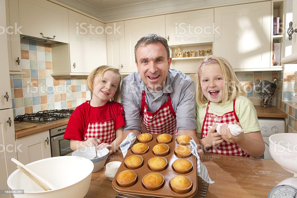 Father and Daughters Baking Cupcakes royalty-free stock photo