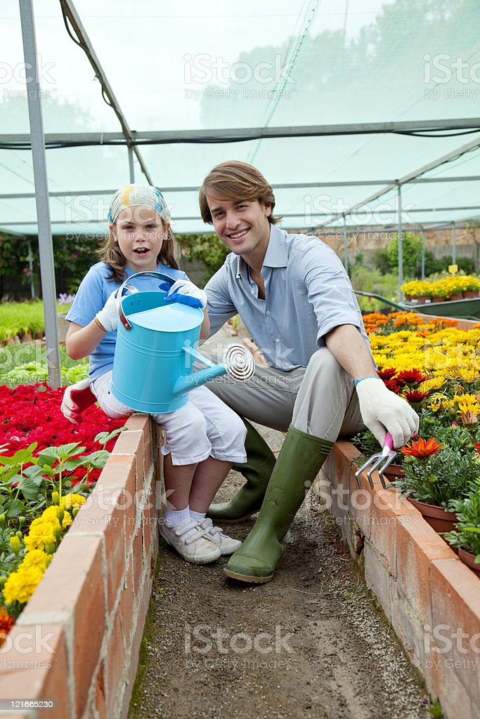 Father and daugther gardening royalty-free stock photo